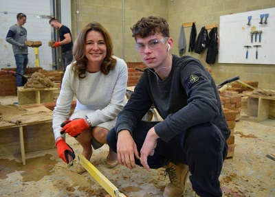 Gillian Keegan MP learning about bricklaying at Chichester College. She is the Chair of the All-Party Parliamentary Group for Apprentices and was an apprentice at 16 in Liverpool